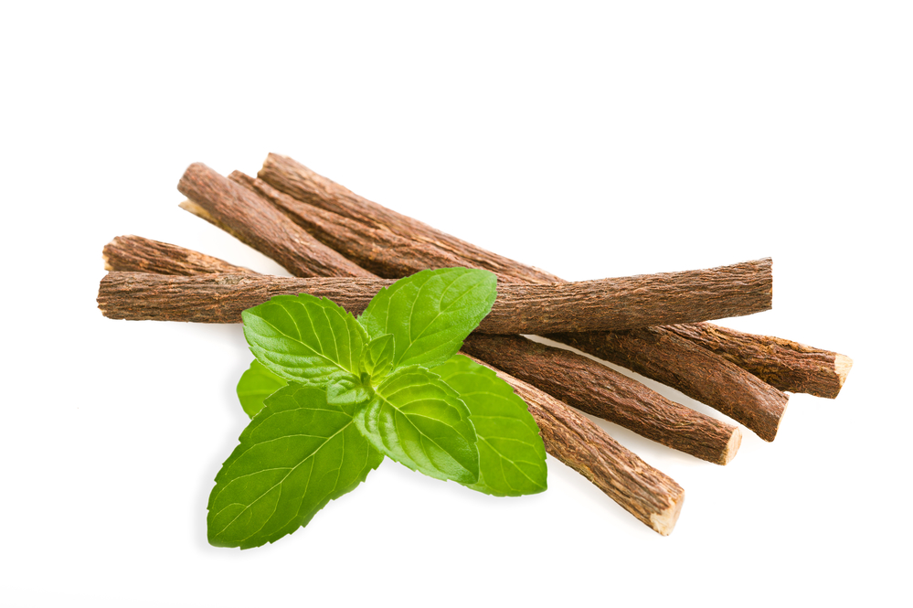 Roots licorice and mint isolated on white